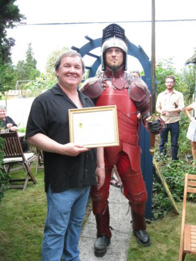 Shane being recognized by the Dundas St. Crossing Knight for his contributions to Slow Down Dundas.